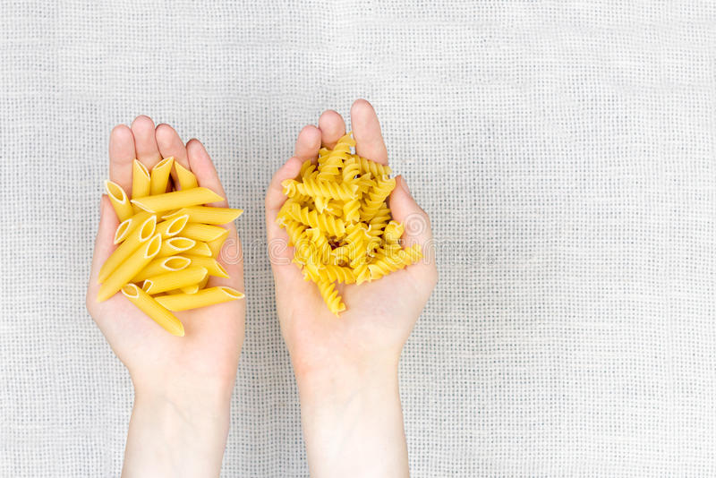 Handful of uncooked pasta flat lay stock images