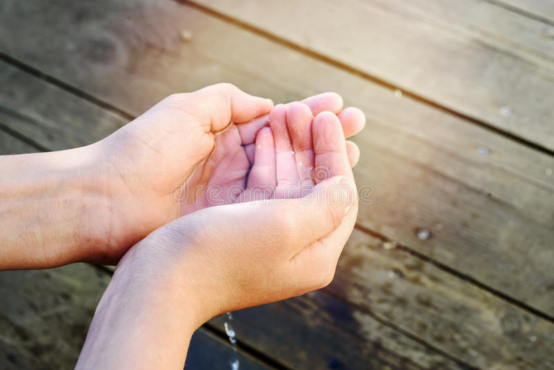 Handful of water in the hands of a child royalty free stock photography