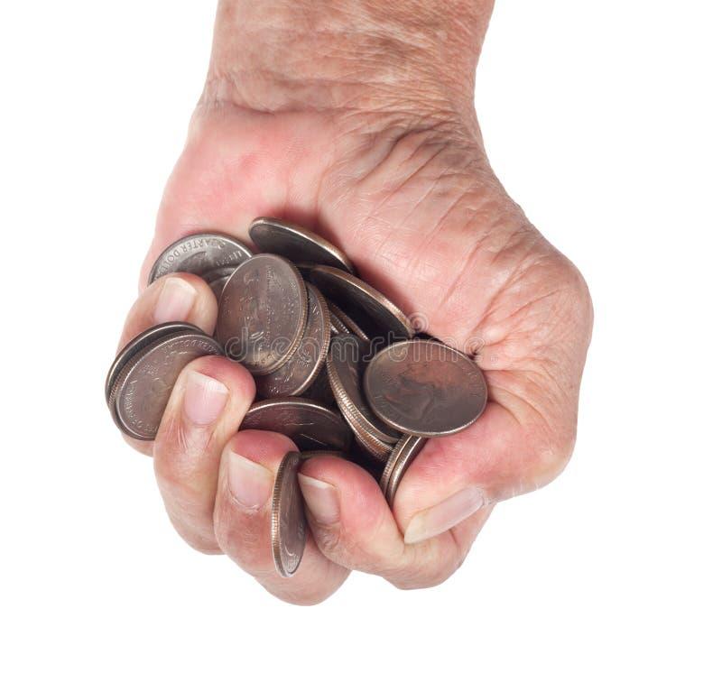 Handfull av mynt arkivbild
