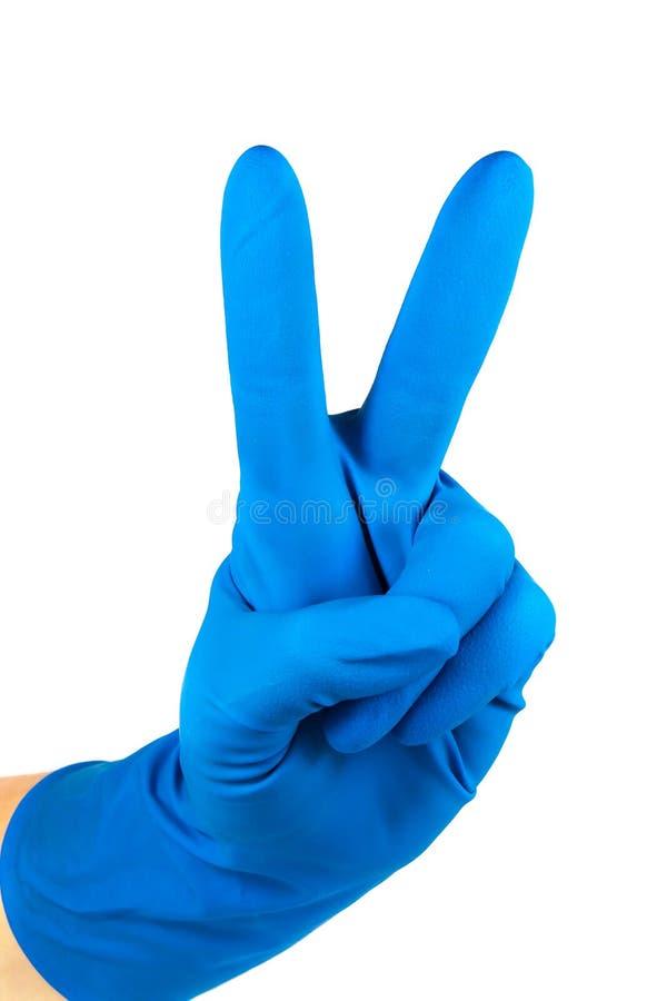 Handgebaar in een rubber medische handschoen van blauwe kleur royalty-vrije stock afbeeldingen