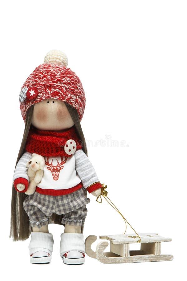 Handgemachte Puppe in der hellen Kleidung mit dem natürlichen Haar und den Zusätzen stockfotos