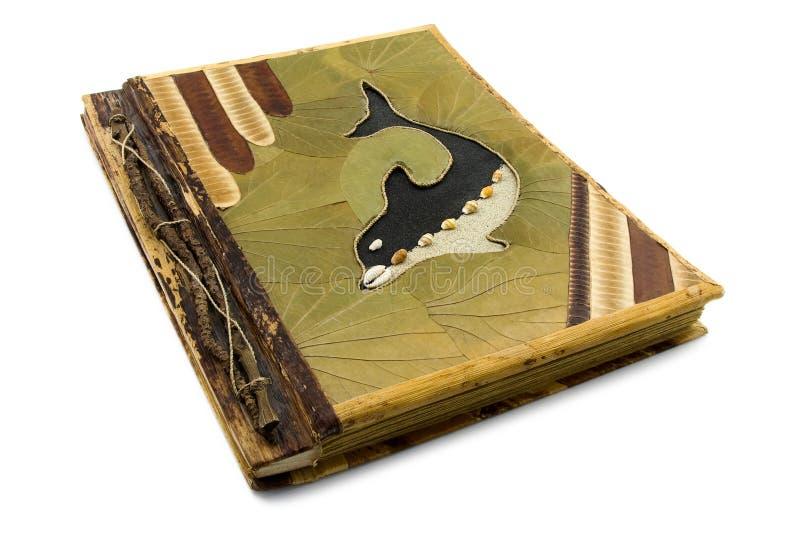 Handgemachtes Fotoalbum mit Delphin auf der Abdeckung. stockfotos
