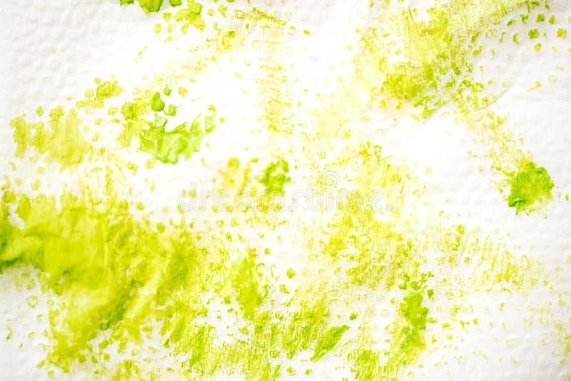 Handgemalter Hintergrund des abstrakten Aquarells Grüner Fleck der Farbe auf einer weißen Serviette stockbild