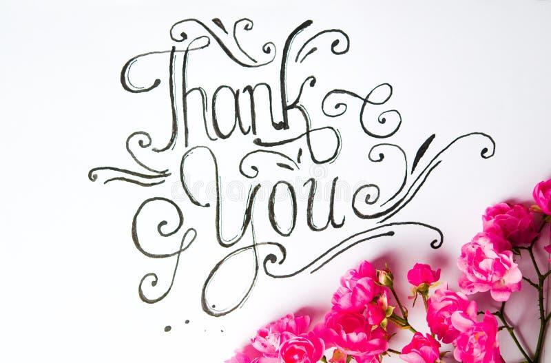 Handgeschrieben danke, mit Blumen zu kardieren stockbild