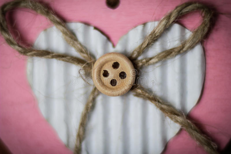 Handgjorda former för hjärta med en knapp arkivfoto