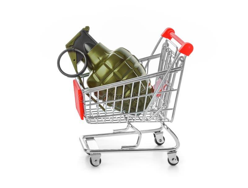 Handgranat i shoppingvagn royaltyfria foton