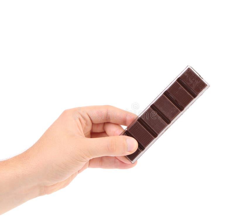 Handgreep twee stukken van chocolade. stock foto