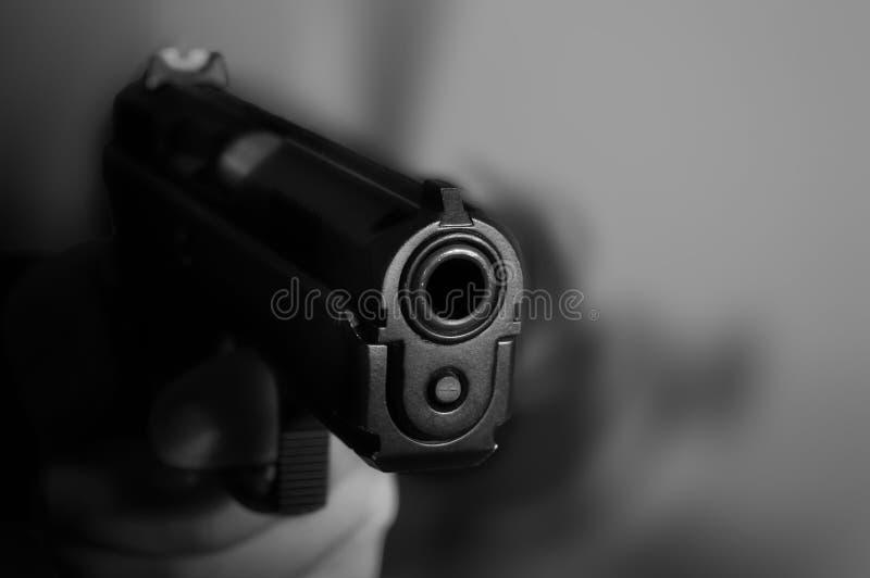 Handgun. Black and white photo of a handgun with motion blur royalty free stock photo
