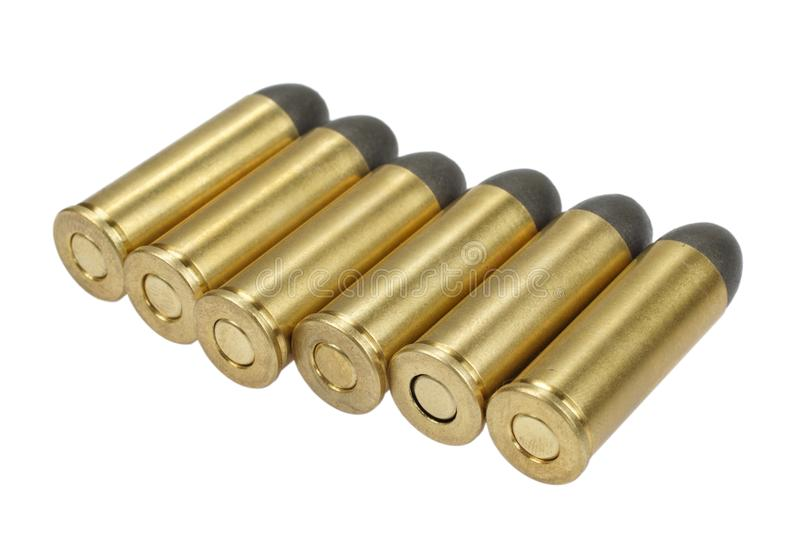 The handgun cartridges dating to 1872 isolated on white. The .45 handgun cartridges dating to 1872 isolated on white stock photography