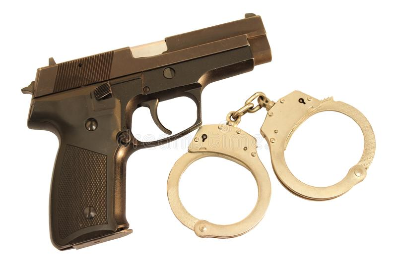 Gun and closed handcuffs isolated royalty free stock images