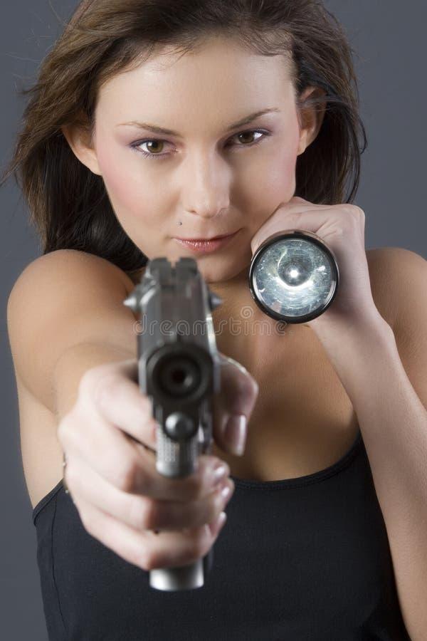 Handgun girl stock image