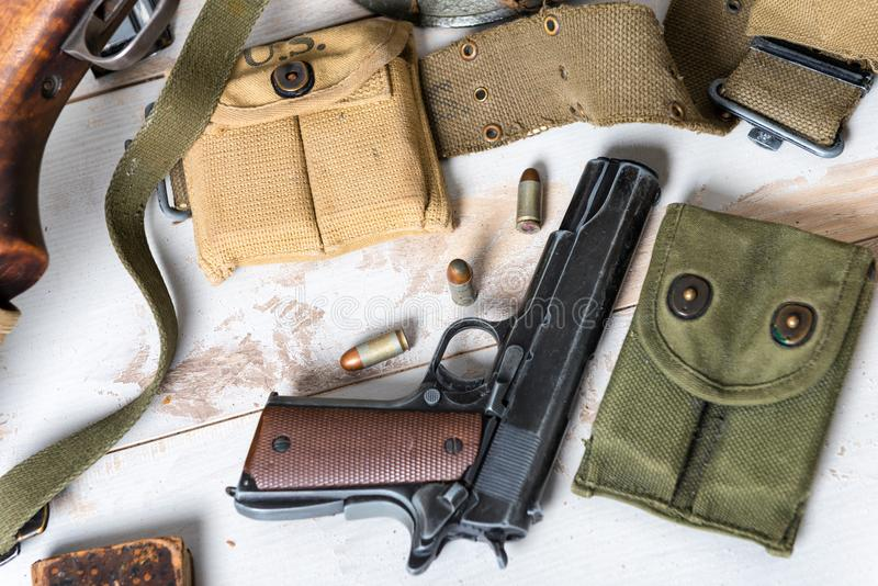 Handgun M1911 government with ammo. Handgun M1911 government with the ammo royalty free stock photography
