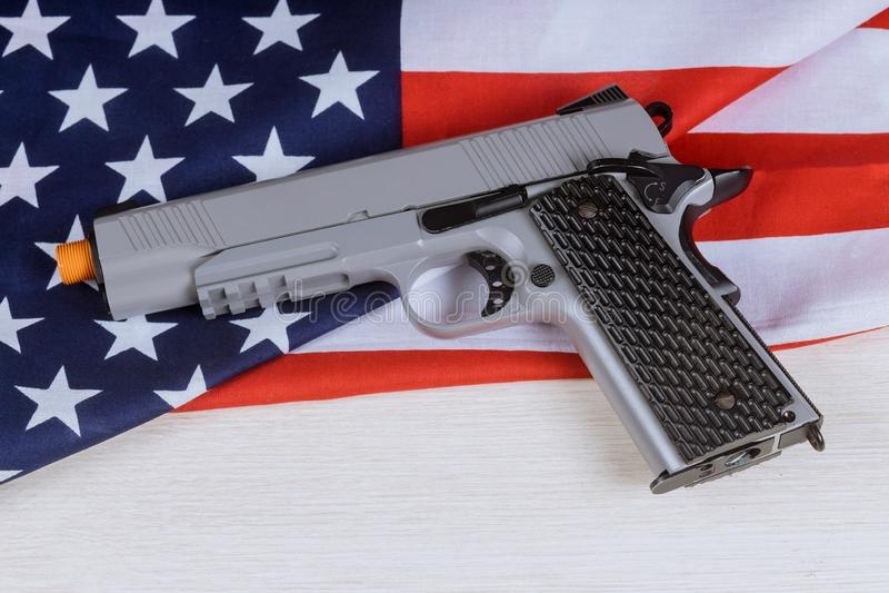 Handgun pistol on American flag crime and punishment. Handgun pistol on American flag and crime and punishment, weapon, usa, freedom, protection, patriotism stock photo