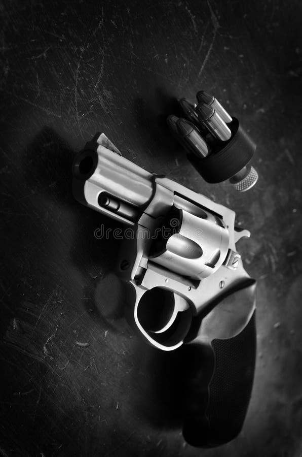 Handgun Revolver Weapon for Defense. Handgun revolver personal weapon for defense on wooden background royalty free stock photo