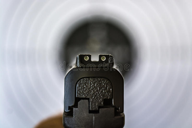 Handgun Sights. Pointing at target in background royalty free stock photography
