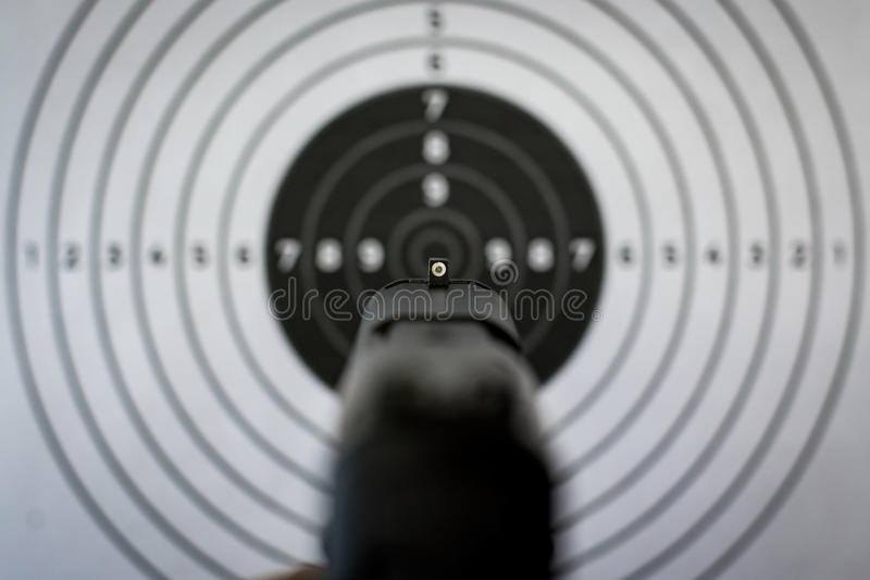 Handgun Sights and Target. Handgun sights, pointing at a target in the background stock photo