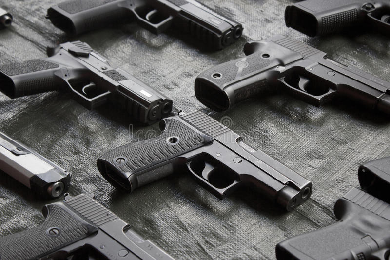 handguns foto de archivo