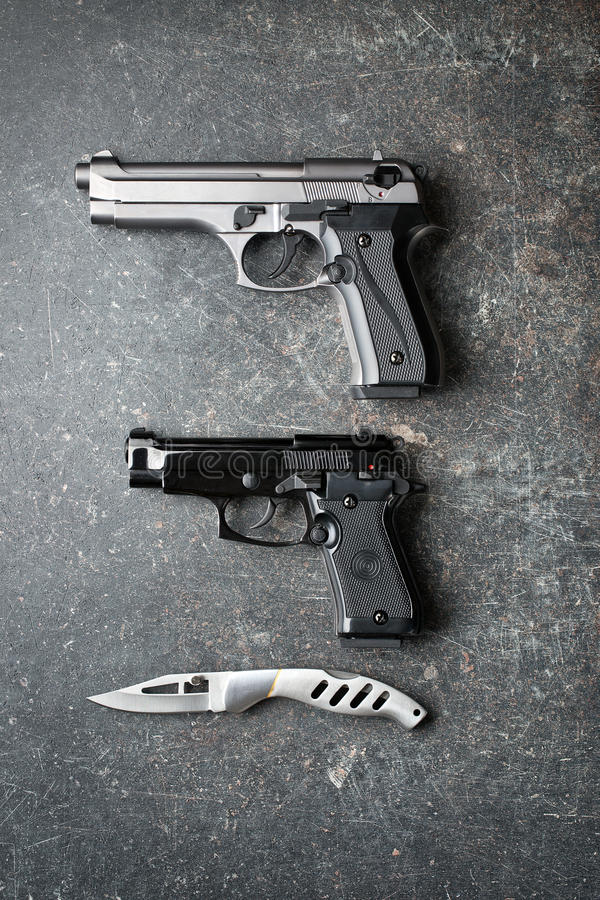 Handguns and offensive knife royalty free stock photos