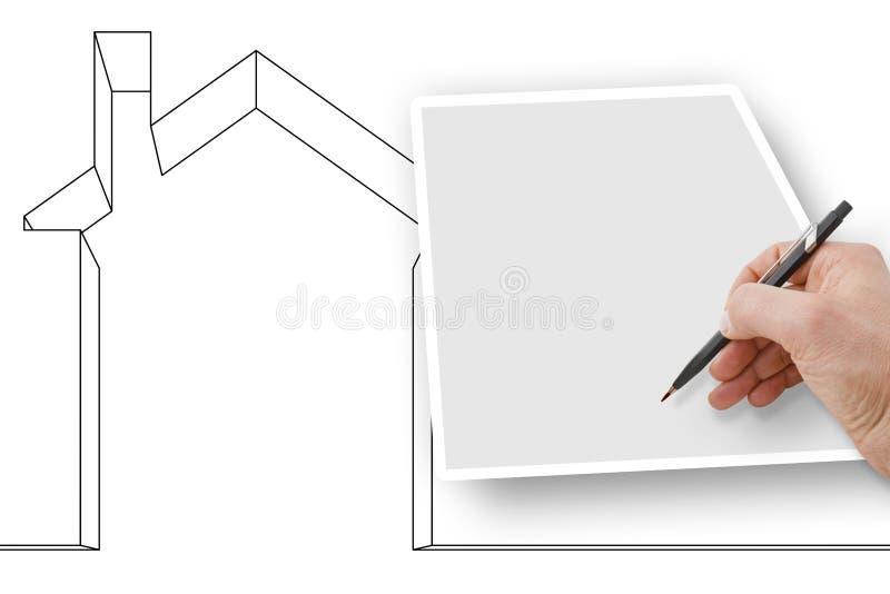 Handhandstil p? ett tomt ark med en hus?versikt p? bakgrund - begreppsbild med kopieringsutrymme arkivfoto