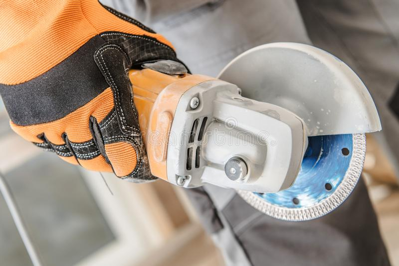 Handheld Circular Saw. In Worker Hand. Construction Equipment royalty free stock photography