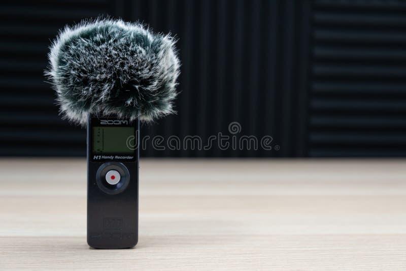 Handheld zoom microphone audio recorder wind screen stock image