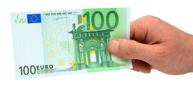 handholding för euro 100 arkivbilder