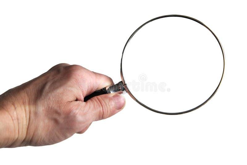 Handholding-Lupe über klein Gedruckte-Mitteilung stockbild