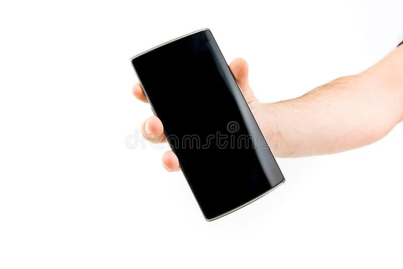 Handholding Zwart Smartphone royalty-vrije stock foto's