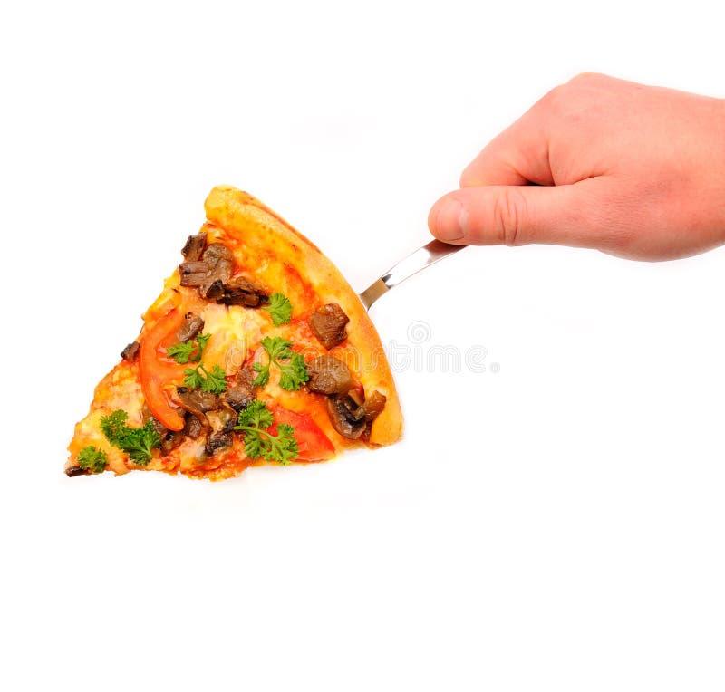 Handholdingscheibe einer Pizza stockbilder