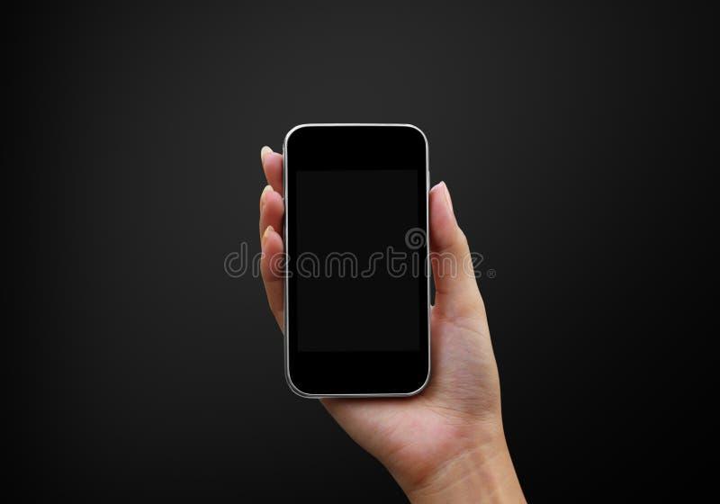 handholdingsmartphones royaltyfri bild