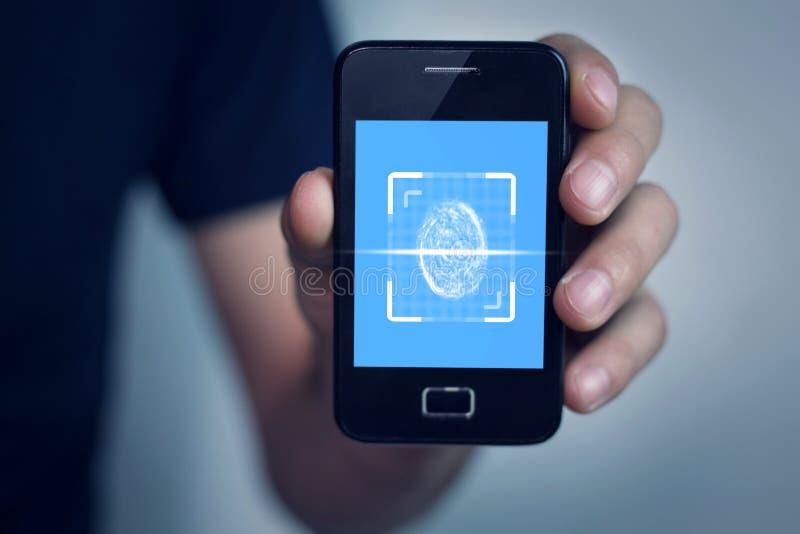 Handholdingtelefon mit Fingerabdruckscanner lizenzfreies stockbild