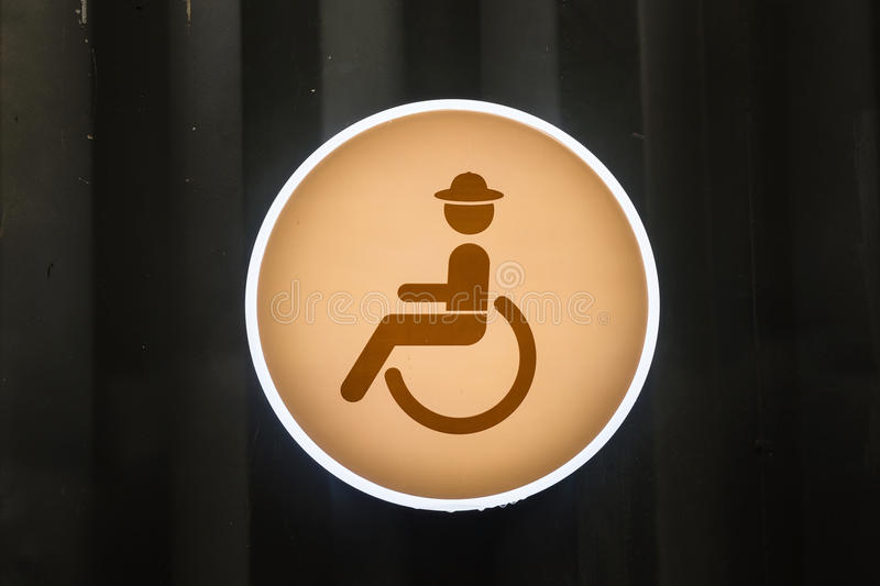 Handicap or Disabled toilet sign. On zinc wall vector illustration