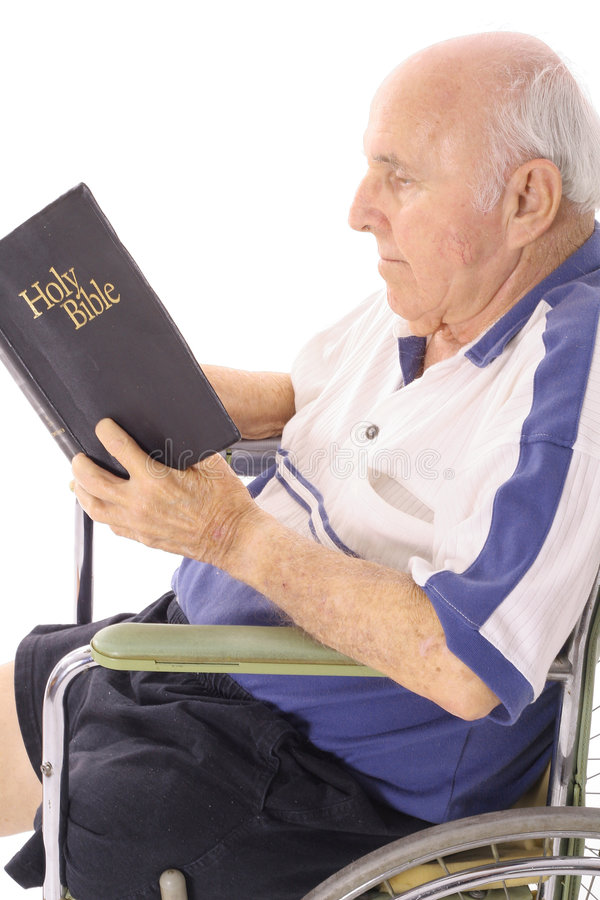 Handicap elderly man daily devotion. Isolated on white royalty free stock photos