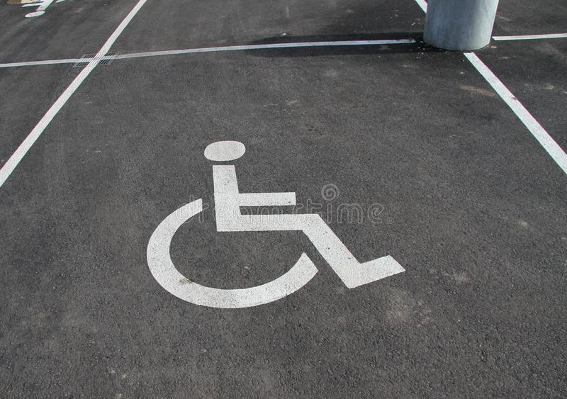Handicap icon. Parking lot with handicap sign and symbol. Empty handicapped reserved parking space with wheelchair symbol. Disable royalty free stock photos