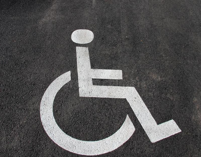 Handicap icon. Parking lot with handicap sign and symbol. Empty handicapped reserved parking space with wheelchair symbol. Disable. D person sign. Copy space stock images