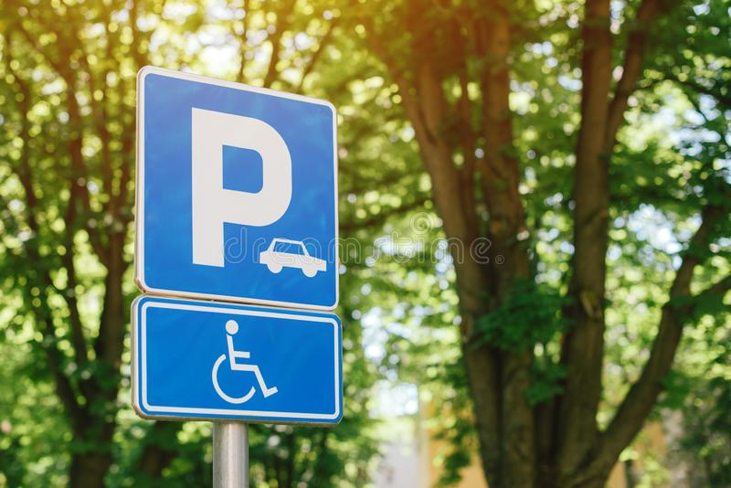 Handicap parking spot sign, reserved lot space for disabled person royalty free stock photography