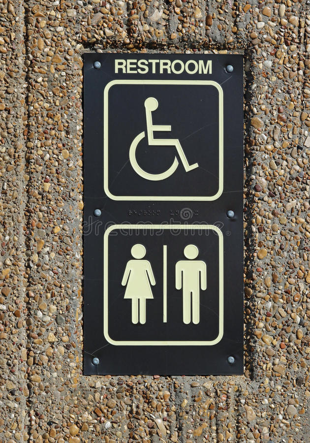 Handicap Restroom Sign. Posted Handicapped Toilet Sign Detail royalty free stock photos