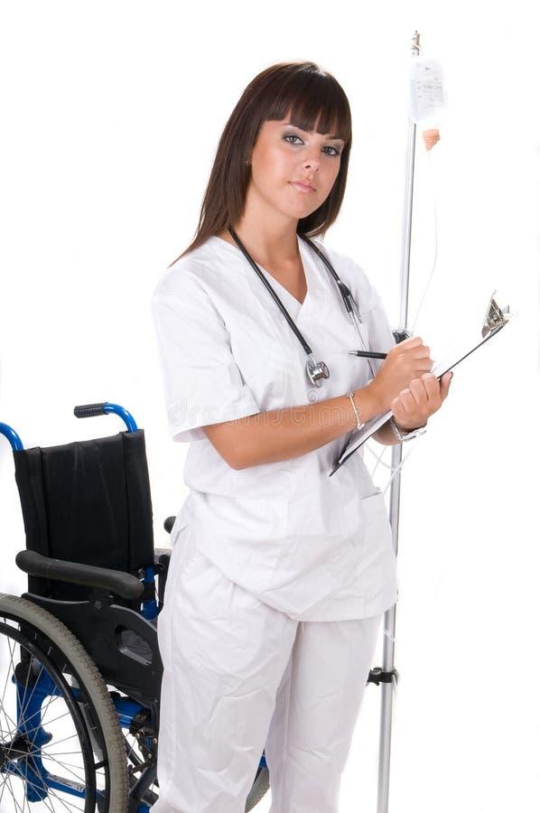 handicaped läkarundersökning för stol doktor royaltyfria bilder