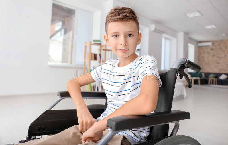 Handicapped boy in wheelchair at home royalty free stock images