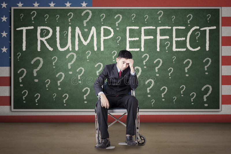 Handicapped businessman with word of Trump Effect royalty free stock photography