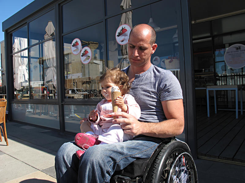 Handicapped Dad With Child Royalty Free Stock Image