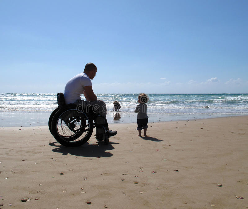 Handicapped Dad With Child Royalty Free Stock Photos