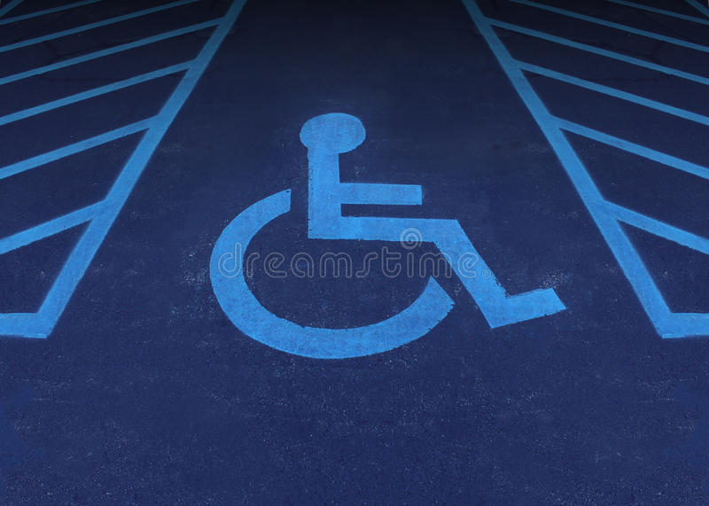 Handicapped And Disabled. Symbol as a parking space with a wheelchair painted on asphalt as a health care and medical icon of reserved space for accessibility stock illustration