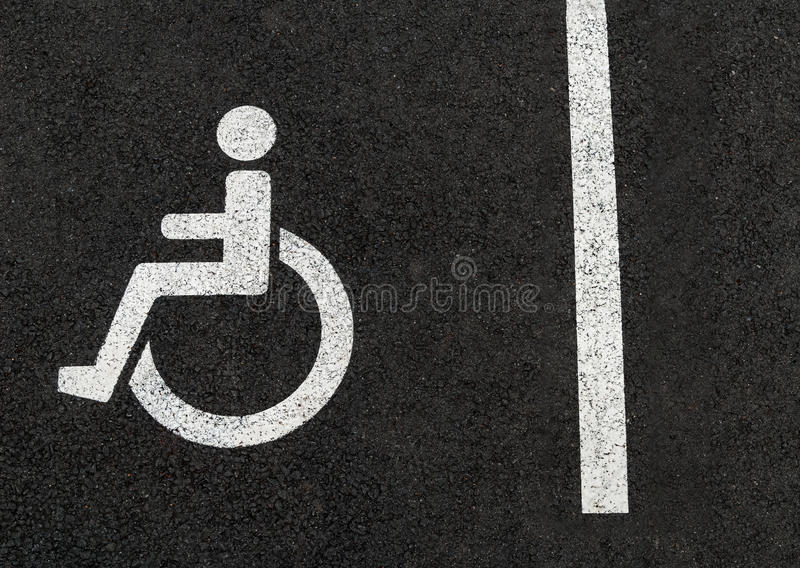Handicapped disabled people parking lot sign for car wheel chair stock photography