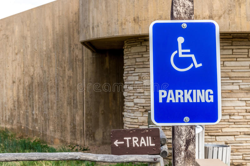 Handicapped parking sign. Next to a nature hiking rail stock photos