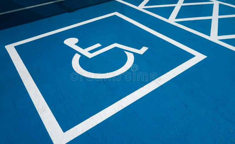 Handicapped parking. Handicapped symbol on parking lot royalty free stock photos