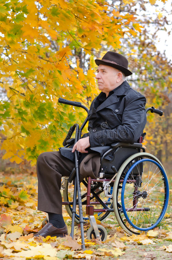 Free Handicapped Senior Enjoying The Autumn Sun Royalty Free Stock Image - 34648576