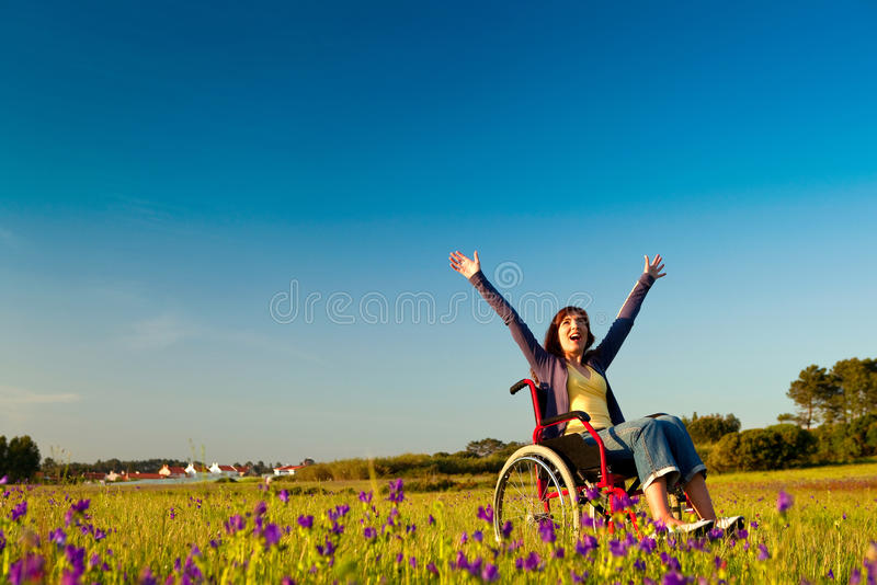 Handicapped woman on wheelchair stock photo
