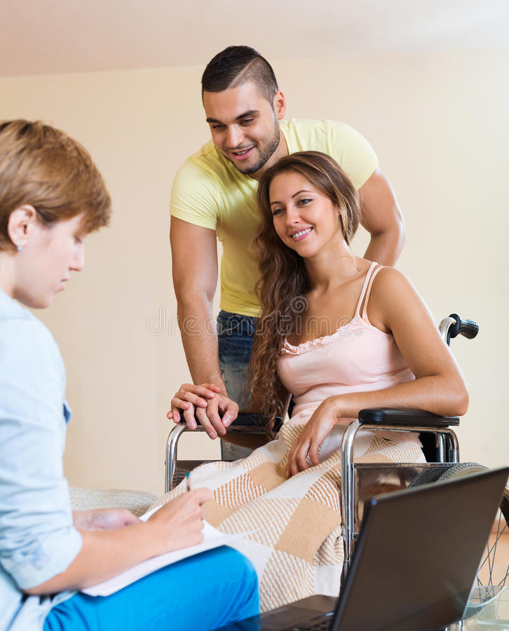 Handicapped woman in wheelchair stock photography