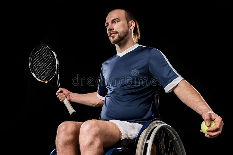 Handicapped young sportsman playing tennis royalty free stock image